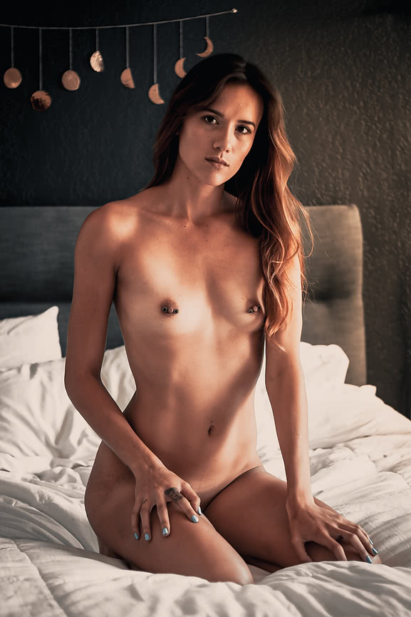 nude portrait of Chloe naked in bed